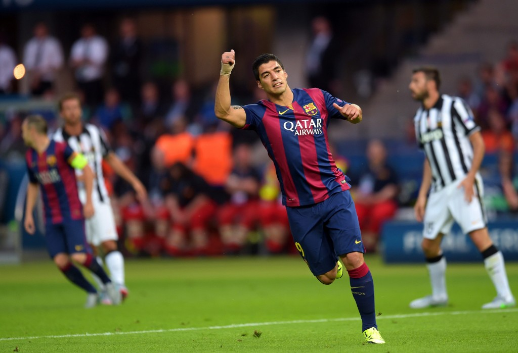 epa04786835 Barcelona's Luis Suarez (2-R) reacts during the UEFA Champions League final between Juventus FC and FC Barcelona at the Olympic stadium in Berlin, Germany, 06 June 2015.  EPA/FEDERICO GAMBARINI